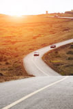 Car running on  cranked road Royalty Free Stock Photos