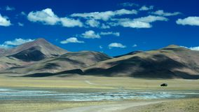 Car running in depopulated zone. Took in Qinghai-Tibet Plateau. Car running in depopulated zone Royalty Free Stock Photography