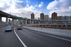 Car running fast on the bridge in city Royalty Free Stock Photography