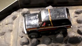 The car is running over an offroad terrain track. Free time. Children and adults concept. Hobby. Toys stock footage