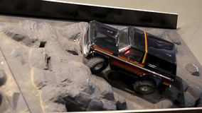 The car is running over an offroad terrain track. Free time. Children and adults concept. Hobby. Toys stock video