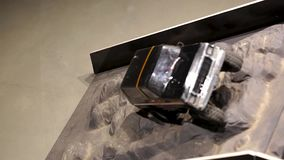 The car is running over an offroad terrain track. Free time. Children and adults concept. Hobby. Toys stock video footage