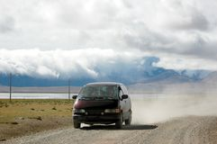 The car running on the Tibetan road Stock Photos