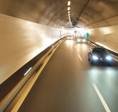 Car running in a tunnel Stock Image
