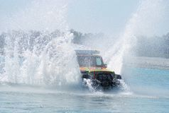 Car running through water. Offroad car passing through the river in Italy and spraying water around stock images