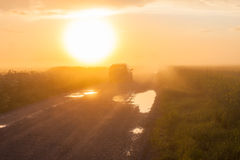 Car on rural foggy road Royalty Free Stock Photos