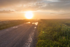 Car on rural foggy road Stock Image