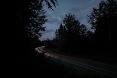 Car on rural road at night Royalty Free Stock Image