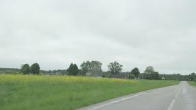 Car rural road rain stock footage