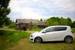 Car in rural Russian village landscape in summer Royalty Free Stock Photo