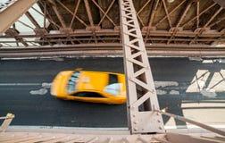 Car rushing over Brooklyn Bridge Royalty Free Stock Image