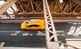 Car rushing over Brooklyn Bridge Stock Images