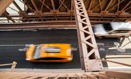 Car rushing over Brooklyn Bridge Stock Photography