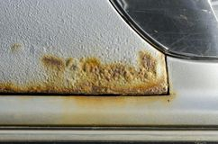 Car with rust and corrosion. Damage from road salt. Close up royalty free stock photos