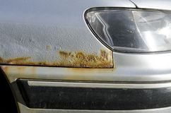 Car with rust and corrosion. Damage from road salt. Close up stock images