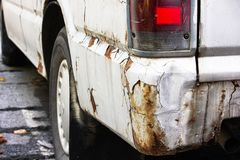 Car with rusty. Close up of old white car rusty, damaged, and flat tires stock photo