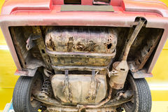 Car with rusty, damaged, corroded undercarriage at workshop for. Repair work Royalty Free Stock Photo