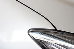 Car's body part with head lamp Stock Photography