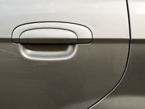 Car's door fragment. Silver metallic car's door fragment with a handle Royalty Free Stock Photography