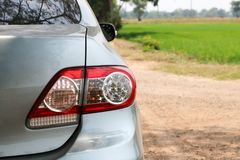 The car`s tail lights in the field. A car is parked in the nature stock photo