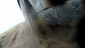 Car's wheels in mud in the forest, off-road. Driving at country road. View from outside car cabin. Slow motion stock footage
