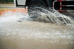 Car's wheels ride on water splashing Royalty Free Stock Images