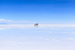 Car on Salar de Uyuni, Bolivia Royalty Free Stock Photo