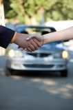 Car sale. The buyer and the seller shake hands. Car sale Royalty Free Stock Photo