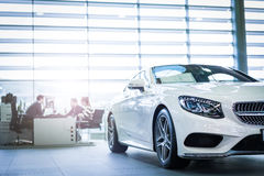 Car for sale. Benz car in dealership showroom for sale stock photos