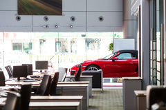 Car for sale. Porsche car at car dealership showroom royalty free stock photos