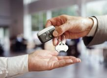 Car sales buying a new car. Handing over the keys Stock Photography