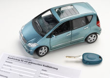 Car and sales contract. Car with purchase agreement and key Stock Photography