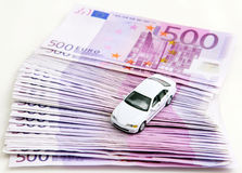Car sales. Car stands on money Royalty Free Stock Photo