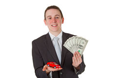Car salesman. With dollars and model car isolated on white background stock photo