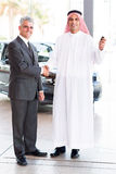 Car salesman Arabic customer Royalty Free Stock Photography