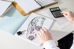 Car salesman calculating a price Stock Photo