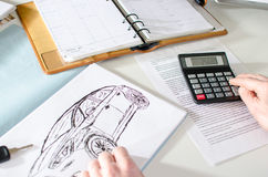 Car salesman calculating a price Stock Images