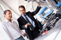 Car salesman with client Stock Image