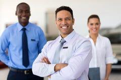 Car salesman colleagues Stock Photo
