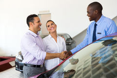 Car salesman couple Royalty Free Stock Photography
