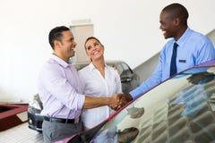 Car salesman couple royalty free stock photography