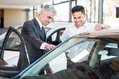 Car salesman customer stock photography