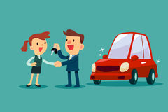 Car salesman give a handshake and new car key to businesswoman Stock Image