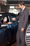 Car salesman giving the car keys Stock Photography