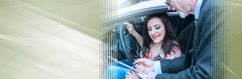 Car salesman giving explanations on clipboard to young woman. panoramic banner. Car salesman giving explanations on clipboard to pretty young woman. panoramic stock photos