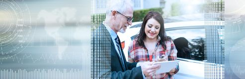 Car salesman giving explanations on tablet to young woman. panoramic banner. Car salesman giving explanations on tablet to pretty young woman. panoramic banner stock image