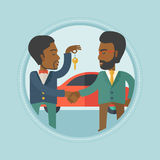 Car salesman giving key to new owner. An african car salesman giving car key to a new owner on the background of car shop. Man buying car and shaking hand to a Royalty Free Stock Photos