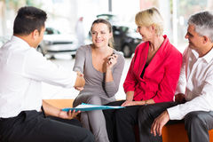 Car salesman handshaking buyer Royalty Free Stock Photography