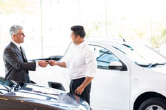 Car salesman key customer Stock Photography