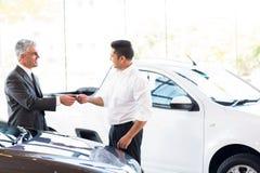 Car salesman key customer stock photography